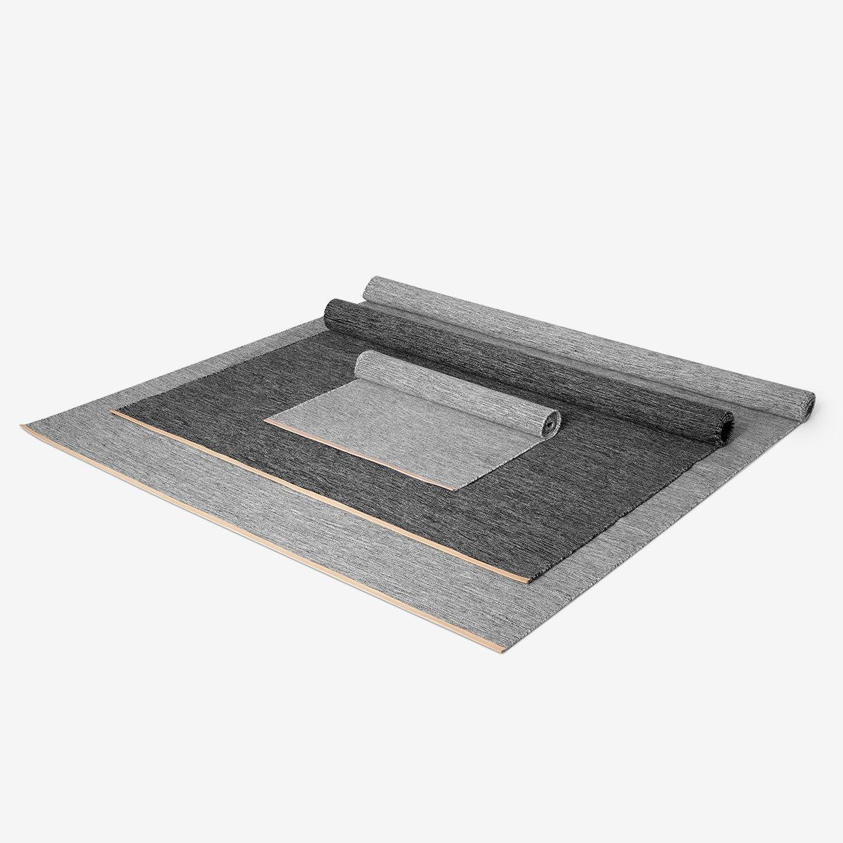 alfombras-bjork-grises-enrolladas